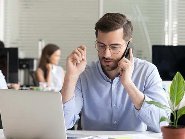 manager tenders - man negotiating on the phone